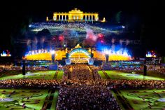 The concert of the Vienna Philharmonic in Vienna, Schönbrunn, before the fountain of Neptune, may 2013. Conductor: Lorin Maazel