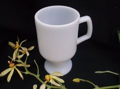 Check out this item in my Etsy shop https://www.etsy.com/listing/239545185/milk-glass-pedestal-mug-milkglass-coffee