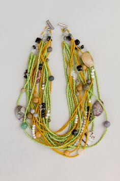 Yellow and green african seed beads necklace by Akweleydesign, $190.00