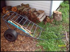 homemade cart with a couple sticks of conduit and some old riding lawn mower tires