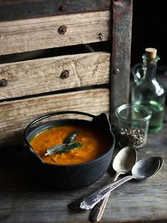 PUMPKIN AND SAGE SOUP INGREDIENTS: 2 medium (6 lbs total) sugar pumpkins (you can substitute with butternut squash) 1 tbsp butter (olive oil for dairy-free) 3/4 cup shallots, diced 3 cloves garlic, chopped 4 cups (950ml) fat free, low sodium chicken broth (vegetarians can use vegetable stock) 1 tbsp fresh sage, plus more for garnish salt and fresh pepper to taste reduced fat sour cream for garnish, (optional)