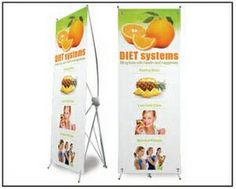 """Vertical Banner with Cross Stand (27""""x75"""")  $45 ea."""