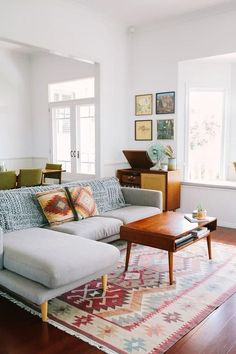 the rug is beautiful with the couch and love that mid century coffee table!