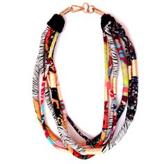 For limited time only Ro's Market brings you the Dread necklace. Crafted from frayed ropes and hand dyed strips of silk it recalls the nomads eclectic accoutrements. $75