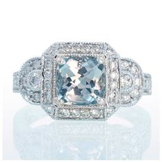 White Gold Aquamarine Vintage Style Halo Three Stone Engagement Anniversary Band Wedding Ring. $2,200.00, via Etsy.