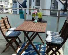 I like this little dining set from Ikea. It makes my balcony a lot cosier