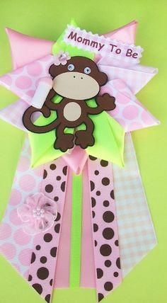 Super Cute Monkey Girl Corsage at  http://www.modern-baby-shower-ideas.com/Monkey-girl-baby-shower.html