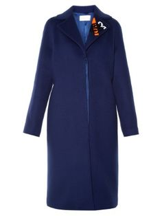 The subtle flash of neon-orange on this navy-blue coat is a Christopher Kane calling card. It's cut to a timeless single-breasted shape with a concealed fastening, and is finished with a sequinned floral motif. Slip it over jeans, dresses, and trousers – the midi length will sit neatly over any hemline.