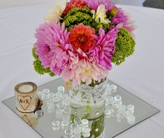 My DIY Rustic Centerpieces: Mason jars with white lace wrapped around. I also glued several silver gems around the jars.