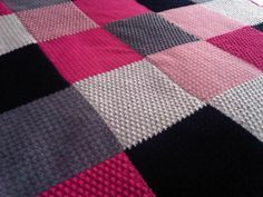 A great version of the Bernat All colors afghan pattern crocheted in Bernat Super Value. Free pattern Ravelry: GigglesLive's Surprise! Hot Pink Block Afghan