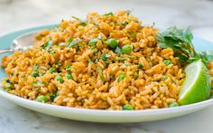 Mexican-Rice-Pilaf-from-Once-Upon-a-Chef ~ My family loves Mexican food so this easy Mexican rice makes a regular appearance at our dinner table. It's not really authentic — true Mexican rice is more complicated and time-consuming to make — but my kids claim it tastes just like the rice served at their favorite Mexican restaurant.