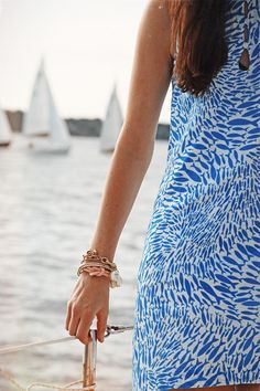 Vineyard Haven Style: blue and white sundress with fish print. Nautical inspired bracelets. Via At The Corner Down The Street