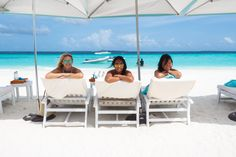 Relaxing on the beach at Four Seasons in Maldives