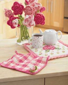 Crochet Rose Dishcloth and Potholder Pattern ~ Crochet a gingham dishcloth with pretty rose embellishment to match a lovely cross-stitch potholder.