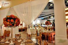 Velos aereos, telas , flores naranjas y tonos terracota / Wedding de Bsquare Rentals  El Salvador
