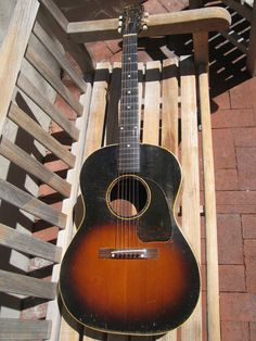 A 1943 Gibson banner headstock almost at beat as my Gibson Acoustic, Acoustic Guitars, Guitar Pics, Cool Guitar, Drums, Banner, Music Instruments, Vintage, Ideas