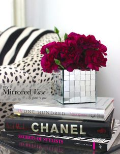 I love this glam DIY mirrored vase I am thinking using the same idea for a tissue box cover for the vanity!