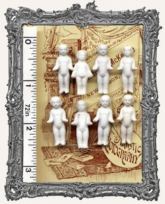 INTACT TINY Antique Frozen Charlotte China Doll XXXSMALL 1 - 1 1/8 Inch. Interesting story about these dolls.