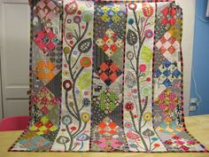 Off the Wall, the wedding quilt love the riot of colors and the use of applique and piecing