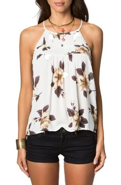 Delicate pintucking gives way to soft shirring on this floral-print top, creating a flowy fit that feels cool in summer heat.