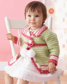 This little Pom-Pom Cardigan is the perfect outfit for your child to wear during the holiday season. It's an easy crochet pattern with an empire waist cardigan and lacy detailing. Sizes are provided for six months to two years old.