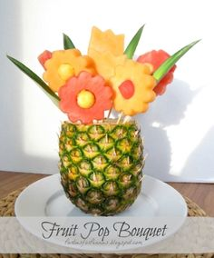 So cute! You can do this with cantelope and watermelons too--or even put real flowers in!