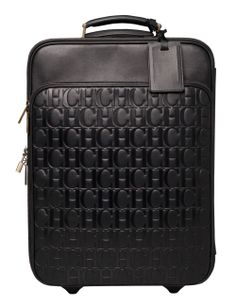 CH Carolina Herrera luggage.