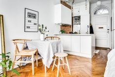 Tiny, charming studio apartment in Stockholm *front door, chevron floor, white with brick