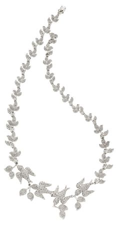 Diamond, White Gold Necklace The necklace features full-cut diamonds weighing a total of approximately 11.00 carats, pavé-set in 18k white gold.