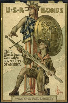 World War I, Third Liberty Loan/Boy Scouts poster, 1918. Lady liberty draped in the American flag holding a large gold shield with a boy scout kneeling in front holding a large sword. Visit the Perkins Archives Flicker page: http://www.flickr.com/photos/perkinsarchive/collections/