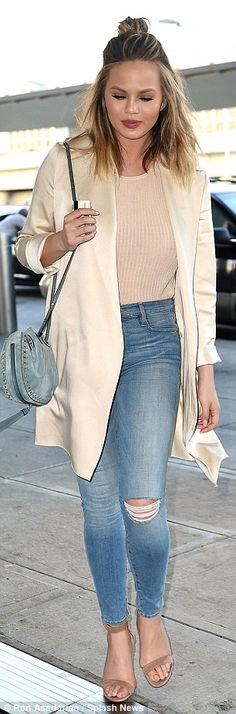 So fly: The star worked nude heels and her glossy coat...