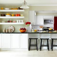 Three upper cabinets on the breakfast room wall were moved to the floor and joined by an additional cabinet to make a stylish buffet.
