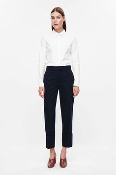 COS image 1 of Wide fold-up slim trousers in Navy