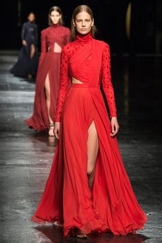 Vibrant orange red for Prabal Gurung in an Eastern influenced peekaboo side stunner of a dress.