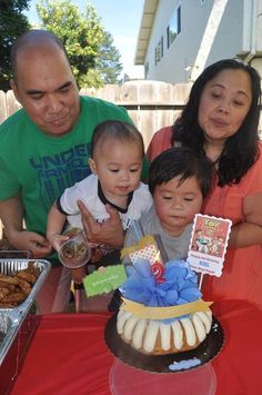Blowing his birthday cake