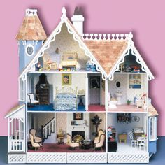 """Any collector looking to display miniatures at eye level or in limited space will find the answer in the McKinley. This unique wall hanging model is just 9"""" deep, yet with 5 large rooms, an attic cubby, and a tower chamber, it has all the potential of a full size house. Three latticed storage drawers beneath enhance the design, and are perfect for storing accessories or hiding electrical components. Decorated in your taste."""