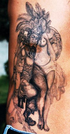 aztec with girl tattoo ideas on rib side - http://tattooswall.com/aztec-with-girl-tattoo-ideas-on-rib-side.html #aztec, aztec tattoos, girl, ideas, on, rib, side, tattoo, with