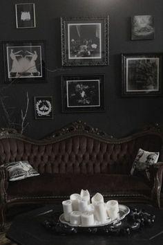 dark walls + tufted antique sofa + candles + gallery wall + victorian #black #decoration #interior: