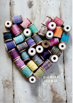 Hearts of spools; fun for the sewing room using the old wooden spools.