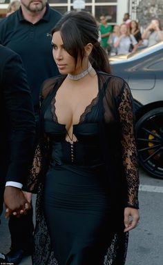Kim was not shy about showing off her cleavage in the revealing dress which was struggling to contain her ample bosom