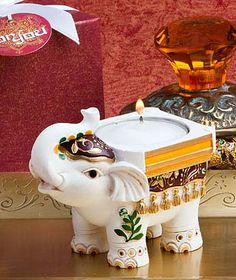 East Indian inspired wedding favors - lovely tealight candle holder is an elephant with his trunk up for good luck. $3.49