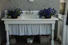 an old cast iron sink would be the perfect outdoor sink!  Love the sides to be able to put things on !