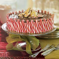 "Loaded with chocolate hunks and peppermint candies, slathered in a decadent chocolate ganache, and decorated with classic Christmas candies, this cheesecake is a ""must-make"" for the holidays."