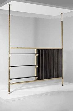 Shelf divider with tension poles from France.