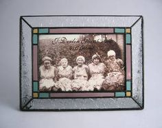 Free Standing Vintage Art Glass Picture Frames by J. Devlin Glass Art add the warmth and elegance of stained glass to your home's decor. Perfect for a wedding gift or other special event.  These Tiffany- inspired pieces are handcrafted and are the original designs of glass artist Kathy Gustafson.
