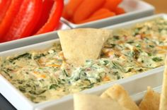 Four Cheese Spinach Dip.  Cream cheese, parmesan cheese, romano cheese, cheddar cheese, and of course, spinach. Yum!