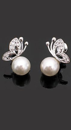 Among my archetype trials for women is to imagine them in the simplest, most symmetric garment and see how it needs adjusting to make any sense on them (or of them). A single strand of pearls for instance. These earrings for YinGamines, the only woman I can see wearing them and looking more like a competent adult.