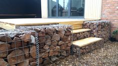 Simple Accoya steps built into Granite filled Gabions supporting the rest of the decking.