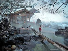 Takaragawa Onsen Rotenburo by John G. Cramer III on Flickr - Gunma, Japan. The hot water travels down the long wooden channel (at lower right) and into the bath.  At this hot spring there are large open air baths on both sides of the river connected by a bridge.  A young woman sits on a submerged wall and takes in the view of the surroundings