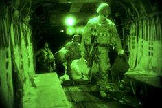 As seen through a night-vision device, U.S. soldiers carry their equipment onboard a CH-47 Chinook helicopter as they prepare to depart for night missions from Forward Operating Base Fenty in Nangarhar province, Afghanistan, July 22, 2013.